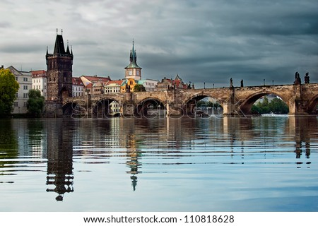 Charles Bridge with reflection in the morning - stock photo