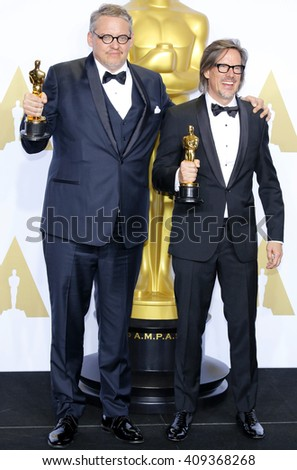 Charles Randolph and Adam McKay at the 88th Annual Academy Awards - Press Room held at the Loews Hotel in Hollywood, USA on February 28, 2016. - stock photo
