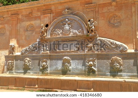 Charles V fountain with beautiful stone decorations near the medieval walls of Alhambra in Granada, Andalusia, Spain - stock photo
