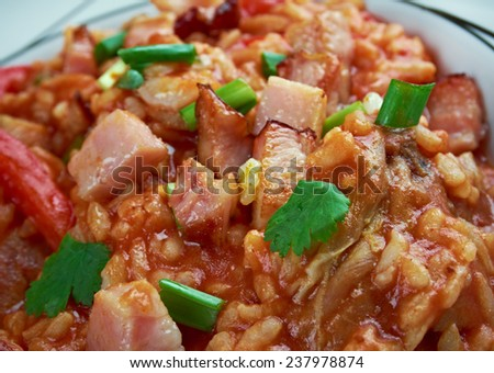 Charleston red rice - Savannah Red Rice  rice dish commonly  Southeastern coastal regions of Georgia and South Carolina.cooking  white rice with  tomatoes , bacon , pork sausage.
