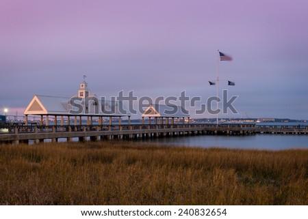 CHARLESTON, SOUTH CAROLINA - DECEMBER 9: Dawn at Vendue Wharf Pier and the Cooper River at Waterfront Park on December 9, 2014 in Charleston, South Carolina - stock photo