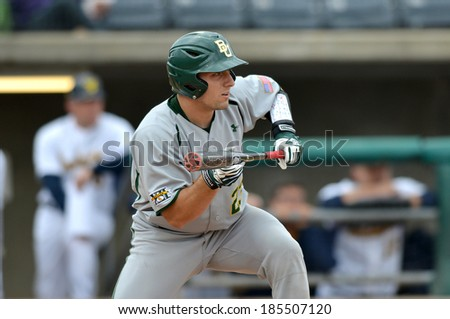 CHARLESTON, WV - MARCH 28:  Baylor catcher Matt Menard #23 squares to bunt during the Big 12 conference baseball game March 28, 2014 in Charleston, WV.  - stock photo