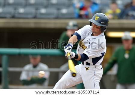 CHARLESTON, WV - MARCH 28: West Virginia outfielder Bobby Boyd #4 prepares to connect with a pitch during the Big 12 conference baseball game March 28, 2014 in Charleston, WV.  - stock photo