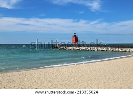 Charlevoix South Pier Light and beach in Northern Michigan - stock photo