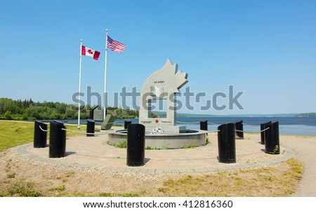 Charlie Lake, Canada - July 7, 2015: Memorial commemorating 12 American soldiers who died on May 14, 1942 during the construction of the Alaska Highway. - stock photo