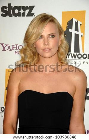 Charlize Theron at the 13th Annual Hollywood Awards Gala. Beverly Hills Hotel, Beverly Hills, CA. 10-26-09