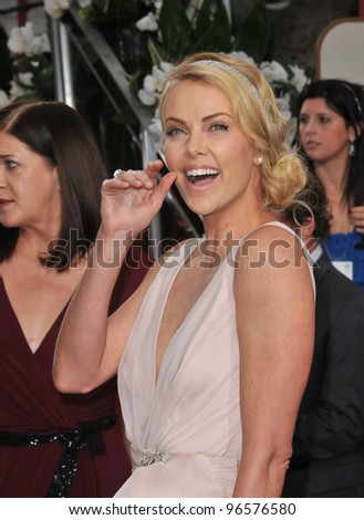 Charlize Theron at the 69th Golden Globe Awards at the Beverly Hilton Hotel. January 15, 2012  Beverly Hills, CA Picture: Paul Smith / Featureflash