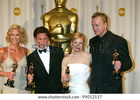 CHARLIZE THERON (left), SEAN PENN, RENEE ZELLWEGER & TIM ROBBINS at the 76th Annual Academy Awards in Hollywood. February 29, 2004
