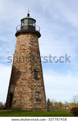Charlotte Genesee Lighthouse, built in 1822, is located on Lake Ontario in Rochester, New York, USA was deactivated in 1881 and is now a museum owned by the county. - stock photo