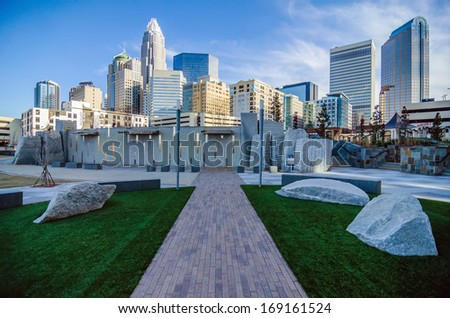 CHARLOTTE, NC - DECEMBER 27, 2013, Charlotte, NC - view of Charlotte skyline at night near Romare Bearden park - stock photo