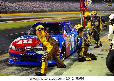 CHARLOTTE, NC - MAY 27:   Kyle Busch tire change at the Nascar Coca Cola 600  at Charlotte Motorspeedway in Charlotte, NC on May 27, 2012 - stock photo