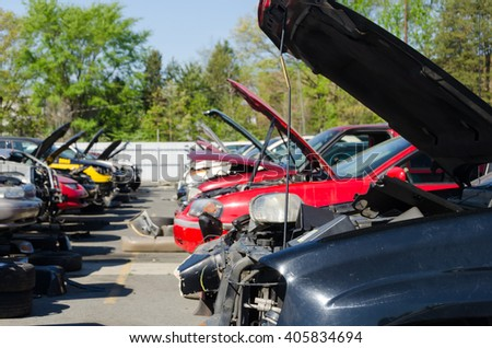 Charlotte, NC, United States - April 14, 2016: Different damaged car on a junk yard in a sunny day
