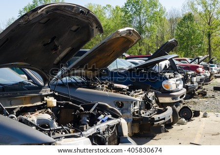 Charlotte, NC, United States - April 14, 2016: Different damaged cars for parts on a Junk yard in a Sunny Day.