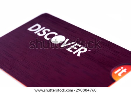 Charlotte, NC, United States - June 26, 2015: Discover credit card close up on white background. Selective focus with shallow depth of field