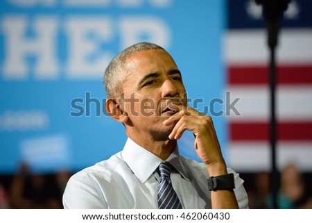CHARLOTTE, NC, USA - JULY 5, 2016: Deep Thought Barack Obama President of the United States gestures on stage as he listens to a speech by Hillary Clinton at the Charlotte Convention Center.