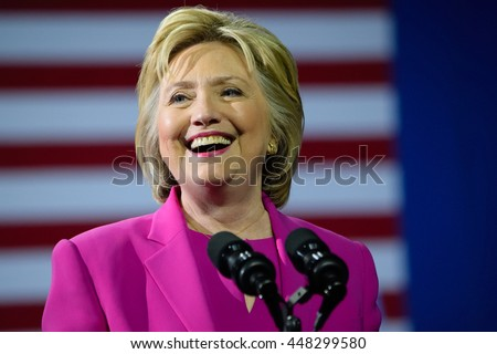 CHARLOTTE, NC, USA - JULY 5, 2016: Hillary Clinton smiling in magenta suit speaks at a rally at the Charlotte Convention Center in a joint appearance with the US President.