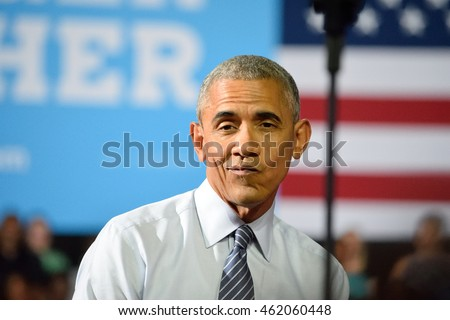 CHARLOTTE, NC, USA - JULY 5, 2016: President Barack Obama reacts with a gesture on stage as he listens to a speech by Hillary Clinton at the Charlotte Convention Center.