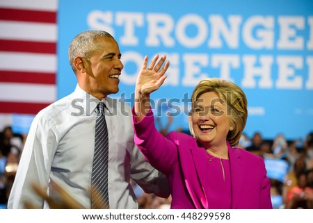 CHARLOTTE, NC, USA - JULY 5, 2016: President Obama and Hillary Clinton take the stage at their first campaign appearance at the Charlotte Convention Center. - stock photo