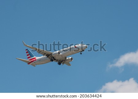 CHARLOTTE, NORTH CAROLINA - JULY 5, 2014:  An American Airlines Boeing 737-823 airplane prepares to land at the Charlotte Douglas International Airport in Charlotte, NC. - stock photo