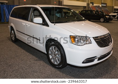 CHARLOTTE, NORTH CAROLINA - NOVEMBER 20, 2014: Chrysler Town and Country mini van on display during the 2014 Charlotte International Auto Show at the Charlotte Convention Center.