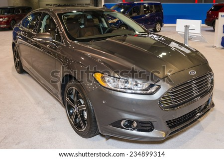 CHARLOTTE, NORTH CAROLINA - NOVEMBER 20, 2014: Ford Fusion sedan on display during the 2014 Charlotte International Auto Show at the Charlotte Convention Center. - stock photo