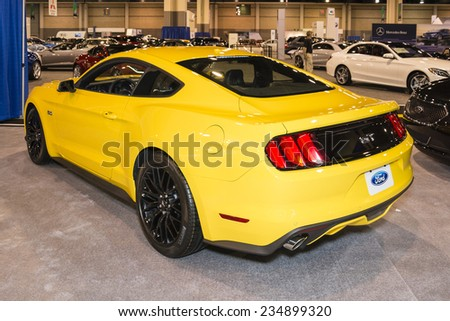 CHARLOTTE, NORTH CAROLINA - NOVEMBER 20, 2014: Ford 2015 Mustang GT coupe on display during the 2014 Charlotte International Auto Show at the Charlotte Convention Center. - stock photo