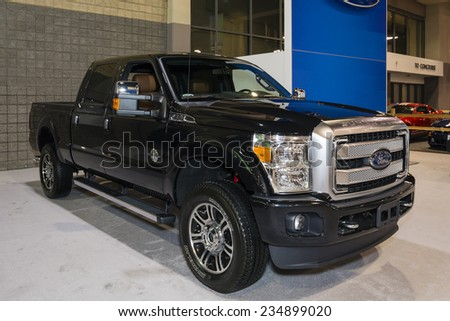 CHARLOTTE, NORTH CAROLINA - NOVEMBER 20, 2014: Ford Super Duty pickup truck on display during the 2014 Charlotte International Auto Show at the Charlotte Convention Center. - stock photo