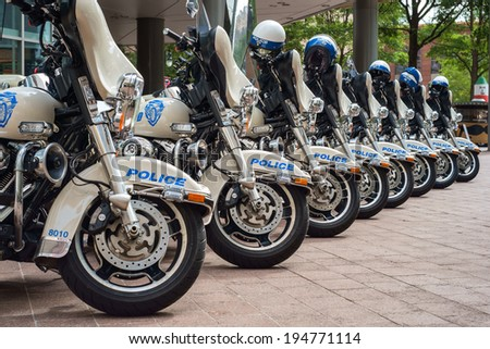 CHARLOTTE, NORTH CAROLINA USA - OCTOBER 10, 2013: Charlotte police department motorcycles lined up outside a municipal downtown building.