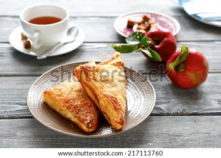 Charlotte with apple stuffing and tea, delicious food - stock photo