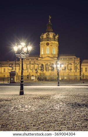 Charlottenburg Palace at night in Winter, Berlin, Germany, Europe, vintage filtered style - stock photo