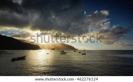 Charlotteville, view on bay with boats during sunset. Tobago island. Trinidad and Tobago.