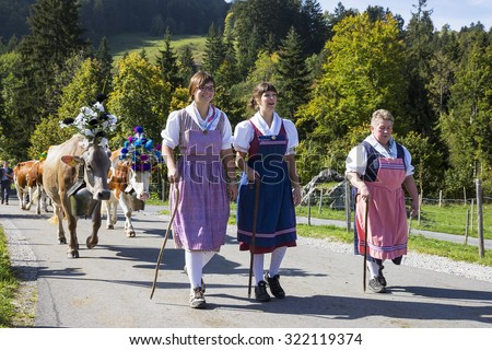 CHARMEY, SWITZERLAND - SEPTEMBER 26, 2015: girls on the annual transhumance at Charmey on the Swiss alps.