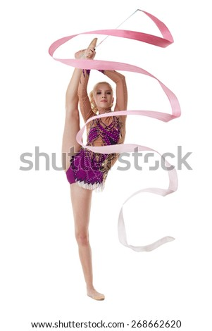 Charming artistic gymnast dancing with pink ribbon - stock photo