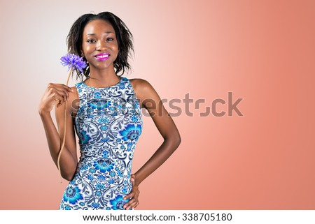 charming beautiful African woman holding flower - stock photo