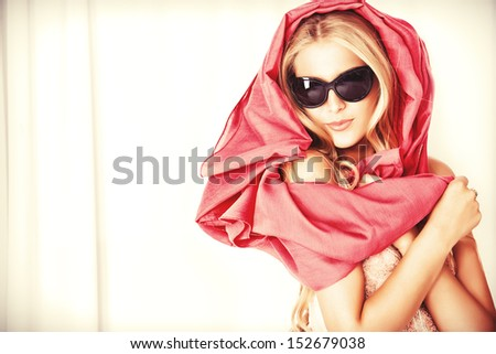 Charming blonde girl in sunglasses. - stock photo