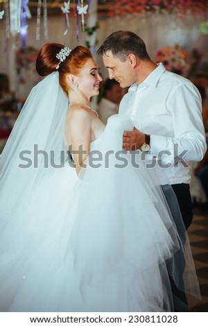 Charming bride and groom dancing on their wedding celebration in a luxurious restaurant. wedding dance of bride and groom - stock photo