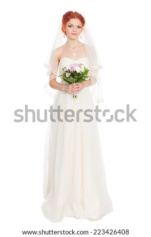 Charming bride in wedding dress with a bouquet of flowers in full growth. - stock photo