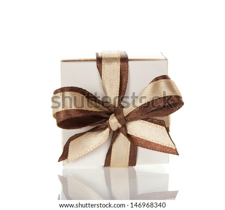 Charming bright bow on the gift box, isolated on white