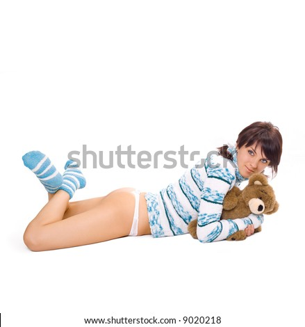 charming brunette embraces teddy bear isolated