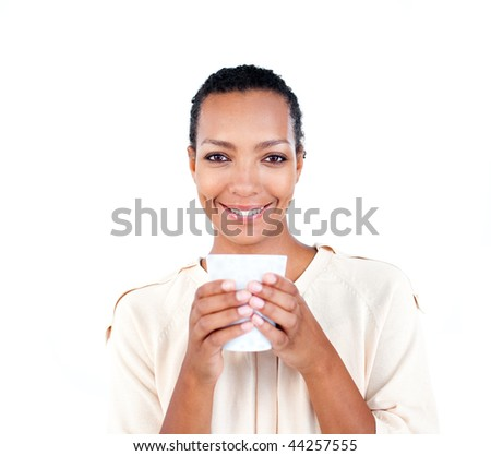 Charming businesswoman holding a drinking cup against a white background