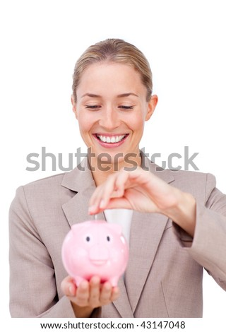 Charming businesswoman saving money in a piggybank isolated on a white background - stock photo