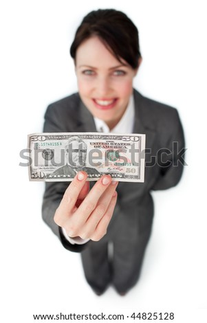 Charming businesswoman showing a bank note against a white background - stock photo