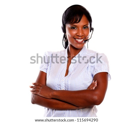 Charming call center employee smiling at you while wearing her headset on isolated background - stock photo