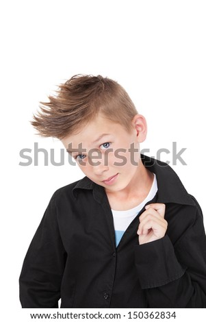 Charming casual kid in black dress shirt and fashionable haircut with cool pose isolated on white background.  - stock photo