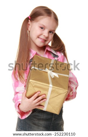 Charming cheerful girl with two tails holding a gift - stock photo