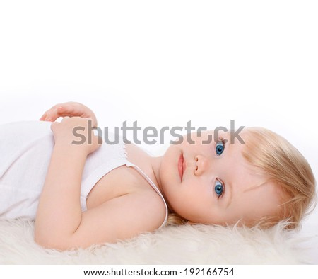 Charming child girl blonde hair on a white background, closeup portrait calm baby - stock photo