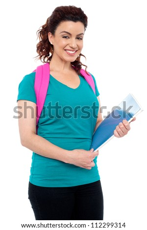 Charming college girl smiling and looking at you. All on white background - stock photo