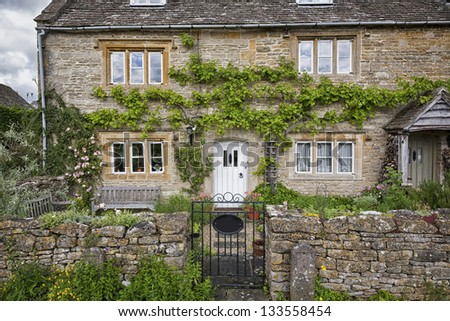 Charming Cotswold cottage in the village Lower Slaughter - UK. - stock photo