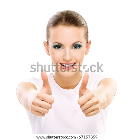 Charming dark-haired successful girl with thumbs up, on white background.