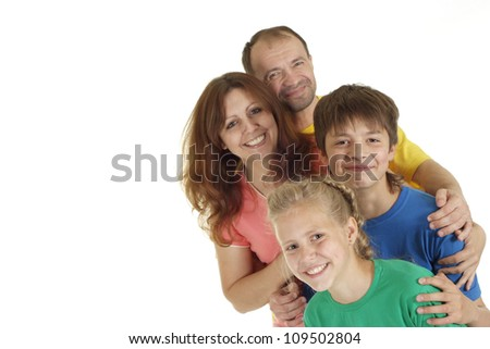 Charming family of four in bright T-shirt on a white background